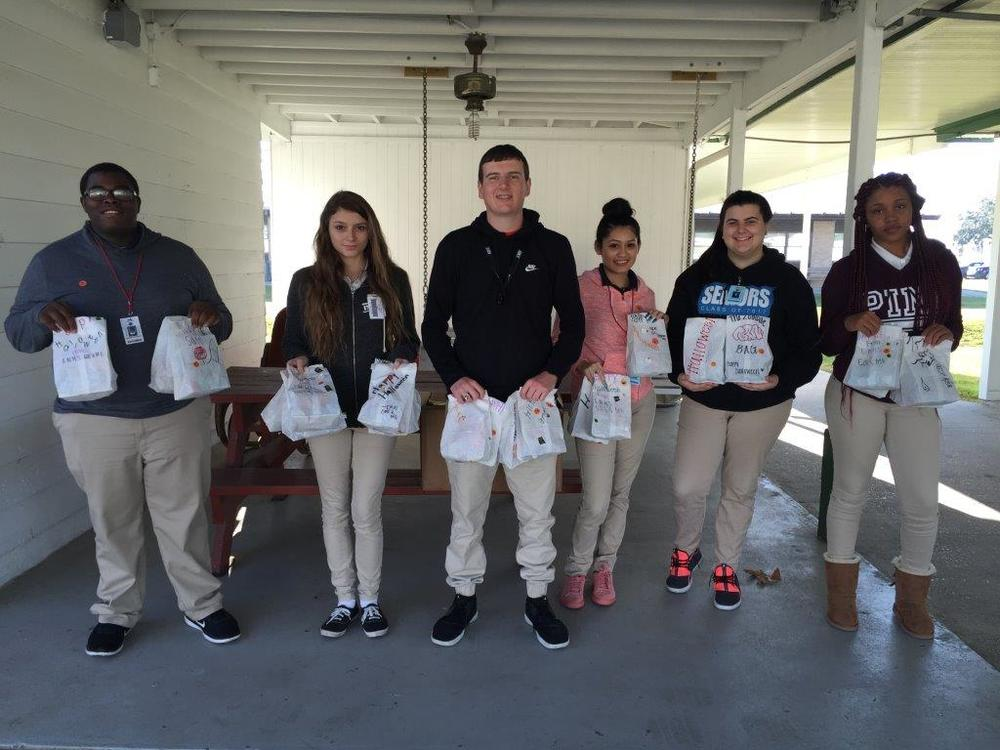 10-31-16 sths coe students delivering candy to sec.jpg