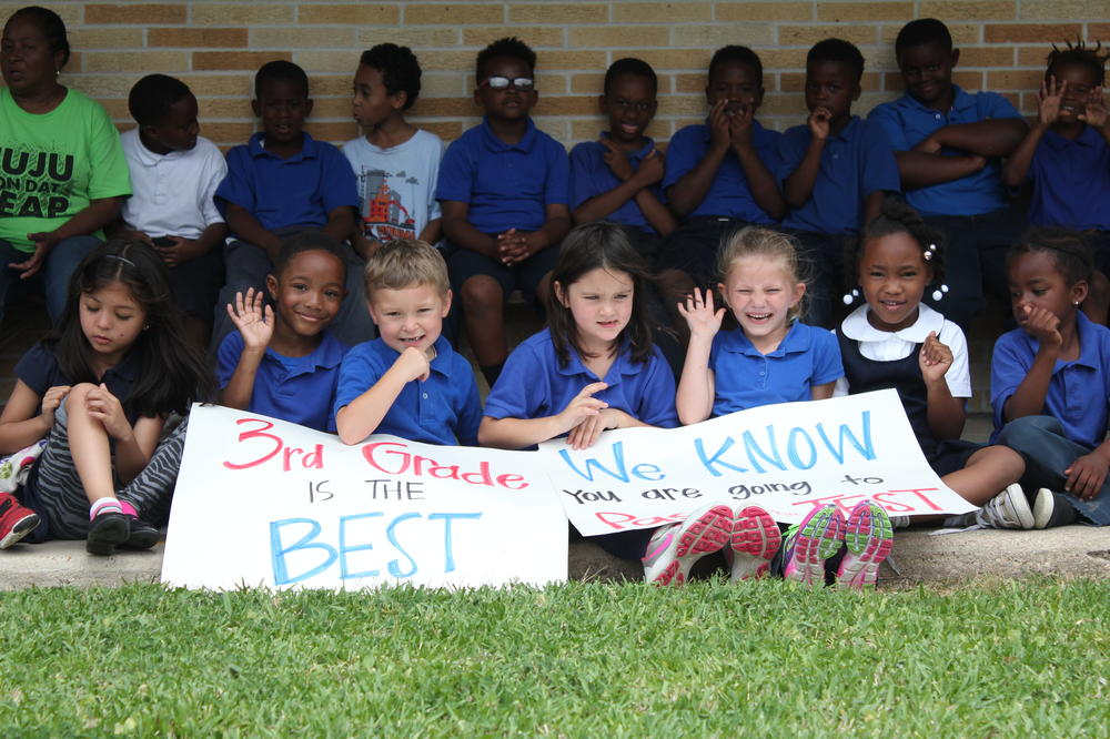 Kindergarten students with their signs.